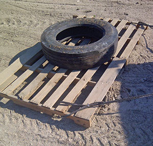 wooden pallets turned into dirt levelers
